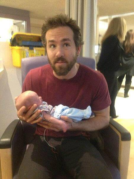 Ryan Reynolds held a baby at the hospital in Ontario on Sunday. Source: Facebook user Blake and Ryan Reynolds