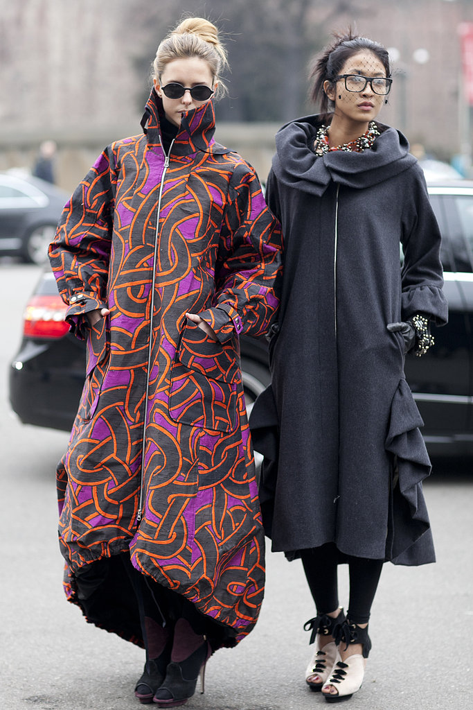 It's no wonder these showgoers got noticed with two equally statement-making coats.