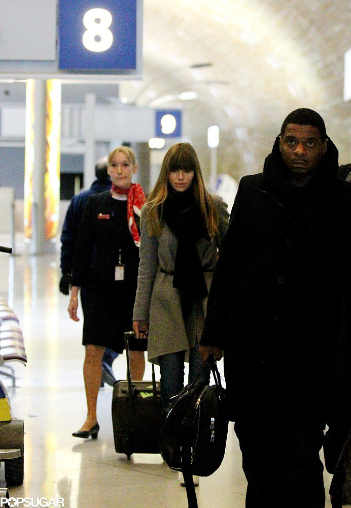Jessica Biel wheeled her luggage through the airport in Paris.