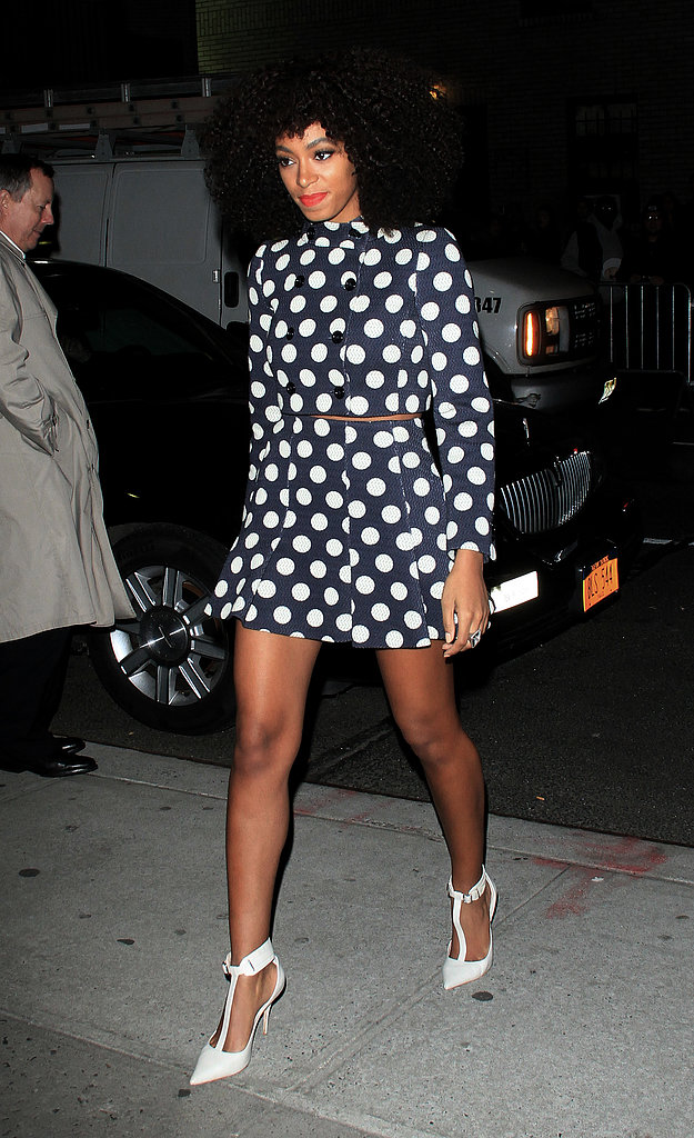 Solange Knowles paired a playful polka-dot coat dress by Moschino with killer white t-strap Elizabeth and James pumps while outside the Ed Sullivan Theatre in NYC.