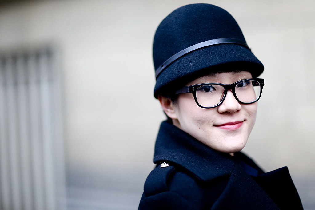 Take a tip from this smart-looking lady: a dusting of sparkle shadow makes your eyes pop behind eyeglasses.