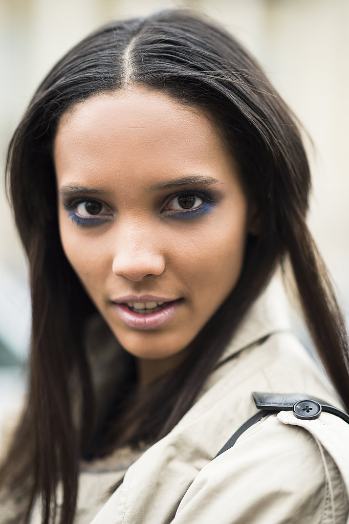 Model Cora Emmanuel smudged some blue hues beneath her eyes for an interesting twist on shadow application. Source: Le 21ème | Adam Katz Sinding