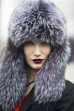 The only possible pairing for Yulia Terenti's incredible chapeau? Darkly hued oxblood lips, of course. Source: Le 21ème | Adam Katz Sinding