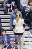 Max Greenfield talked to Kristen Bell at the Kings game in LA.