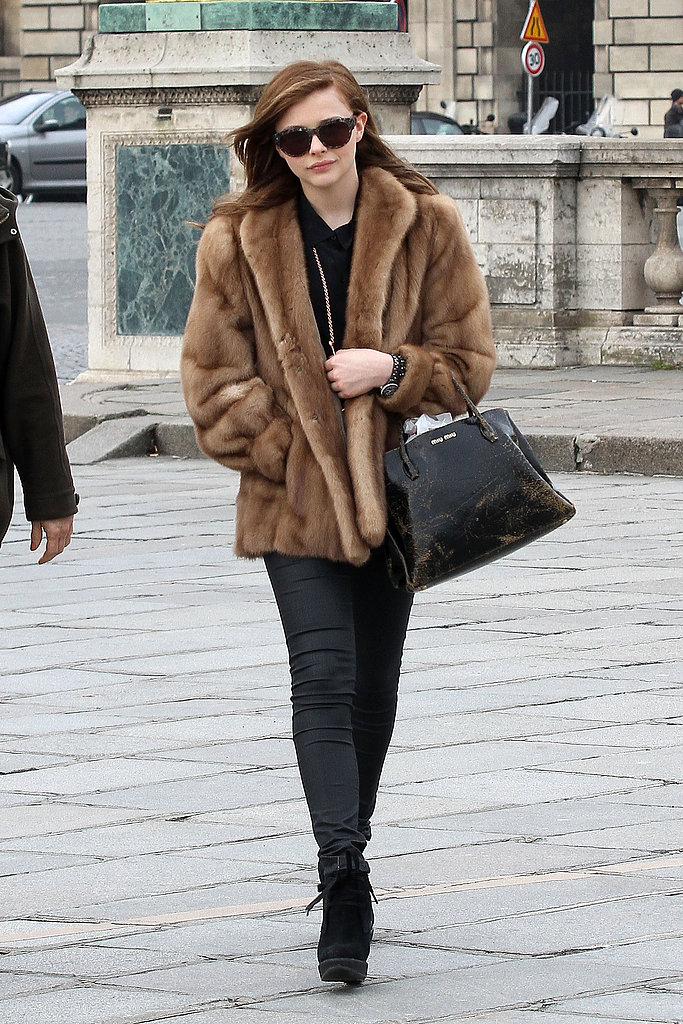Chloë Moretz wore a fur coat as she made her way to a fashion show on Wednesday during Paris Fashion Week.