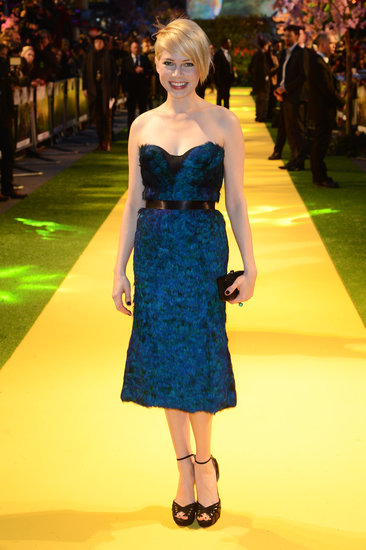 For the London premiere of her flick, Michelle Williams looked beautiful in a peacock feather-embroidered bustier dress by Burberry and black ankle-strap Jimmy Choo sandals.