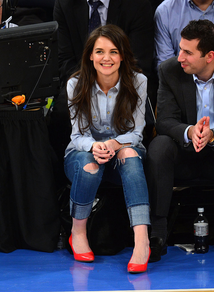 Katie Holmes styled a chambray shirt with distressed boyfriend jeans and punchy neon pumps while cheering on the New York Knicks at Madison Square Garden.