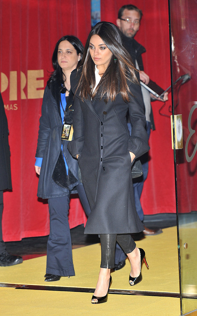 Mila Kunis departed the Oz the Great and Powerful London premiere in cropped black leather pants, a black coat, and black patent Christian Louboutin peep-toes.