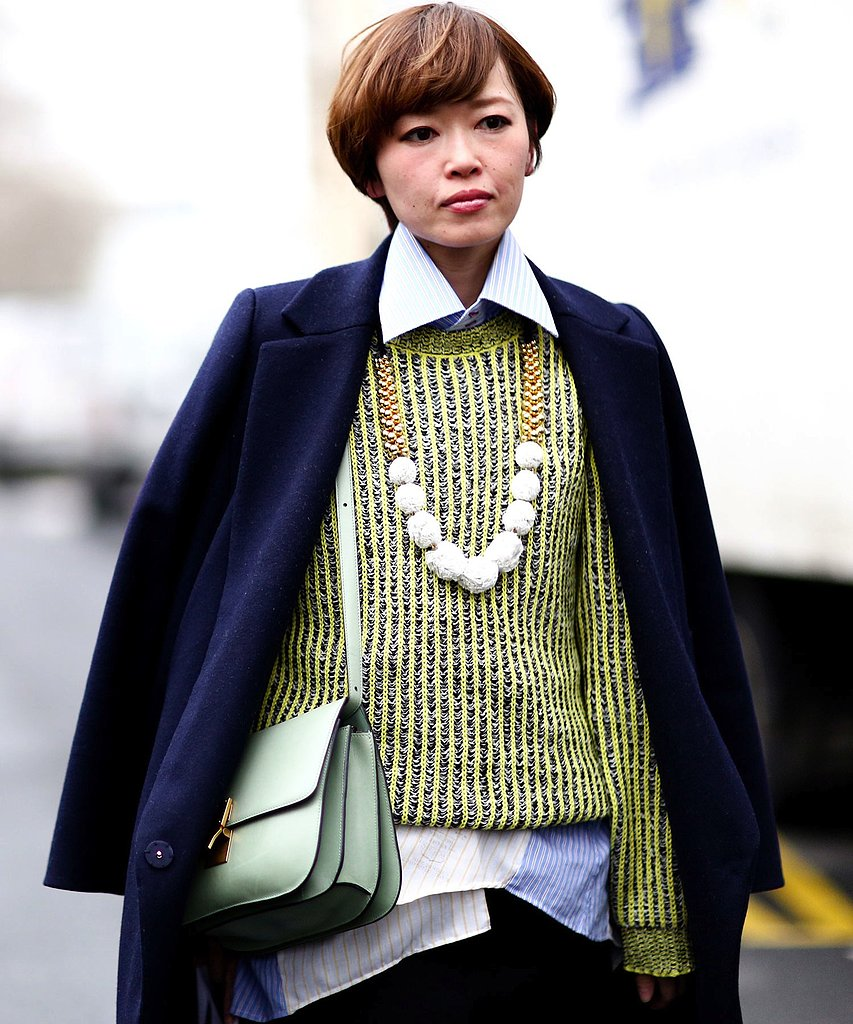 We love the slick styling tips seen here: layer an oversize necklace under a collared top, and try wearing your coat over your bag.