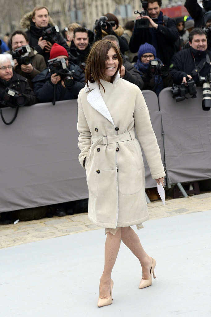 Carine Roitfeld embodied understated sophistication outside of Christian Dior in a shearling-lined trench and nude pumps.
