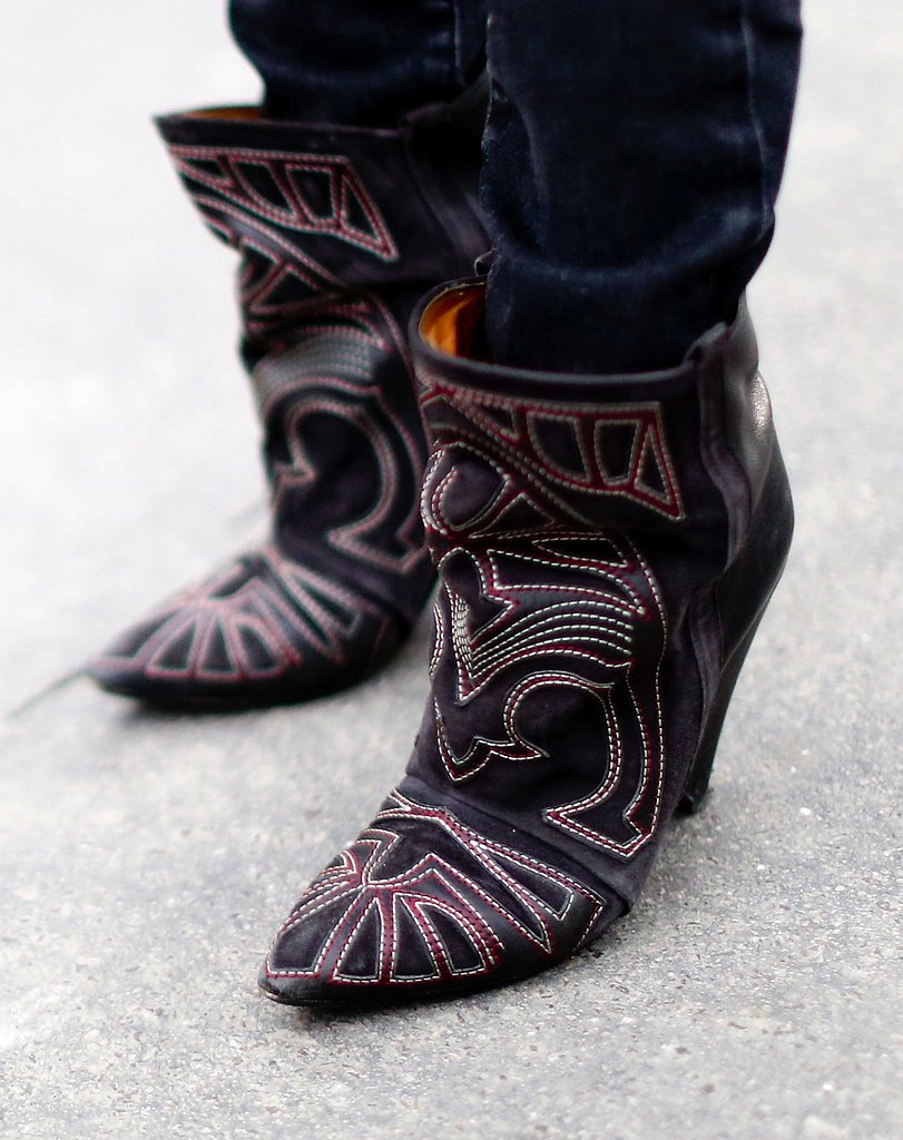 A pair of Western-tinged Isabel Marant boots added a cool-girl tilt to the Fashion Week street scene.