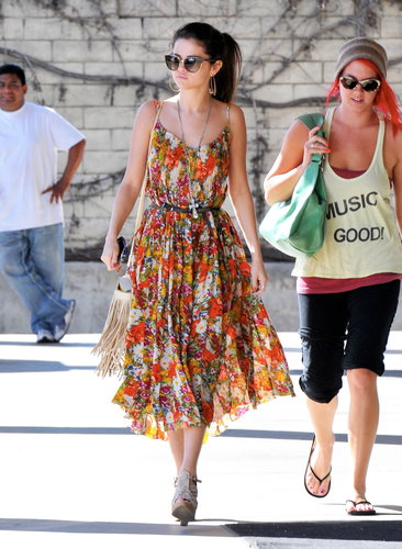 While running errands in Encino, Selena Gomez was Spring-ready in a flowing floral dress, nude wedges, a fringed crossbody, and oversize cat-eye shades.