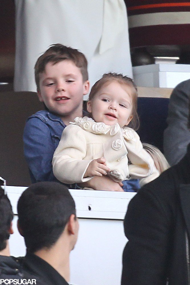 Cruz Beckham held little sister, Harper, while watching dad David Beckham play with Paris Saint-Germain in March.