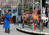 Jessica Alba watched as Honor sat on the merry-go-round.