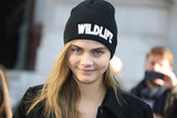 "Model Cara Delevingne wore a ""Wildlife"" hat outside the Stella McCartney show on Monday."