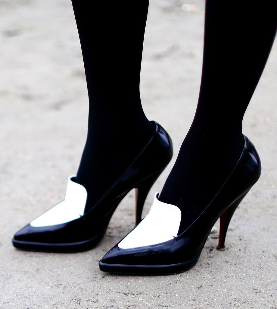 A pair of black and white pumps adds a polished, modern element to any look.