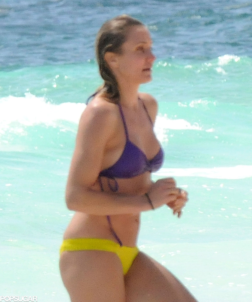 Cameron Diaz wore a bright purple bikini top and neon yellow bottoms while on the beach in Mexico.