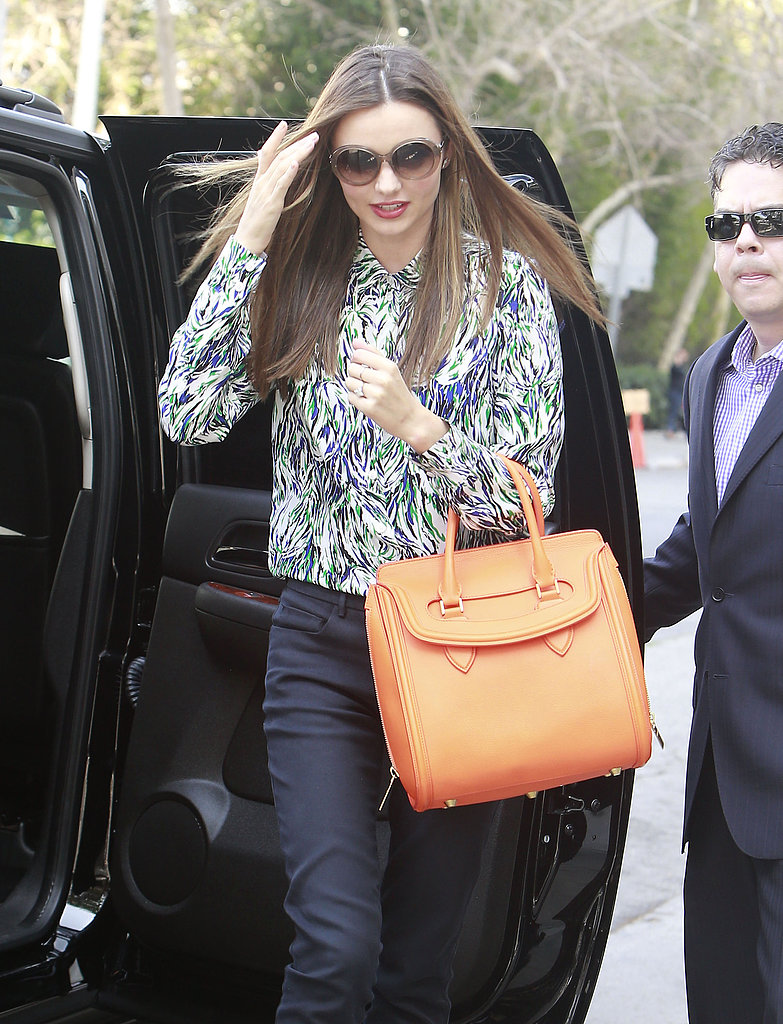 Miranda Kerr Takes a Meeting in Style and Shares a Racy Photo