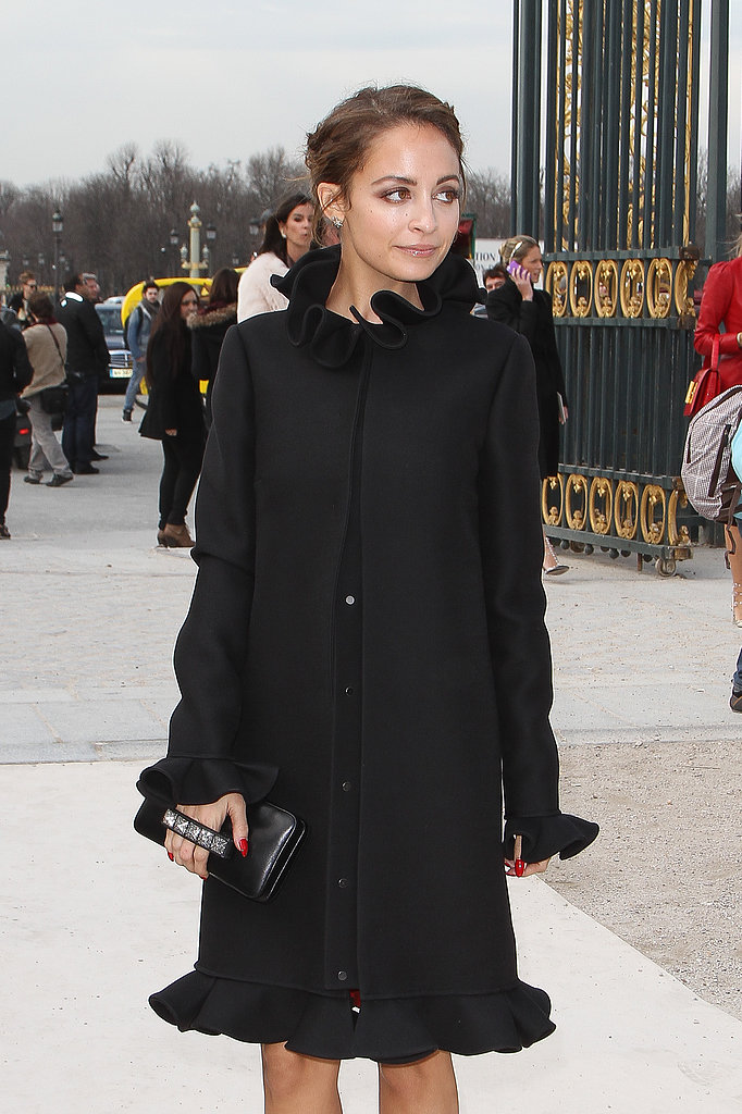 Nicole Richie wore a long black coat outside the Valentino show on Tuesday in Paris.