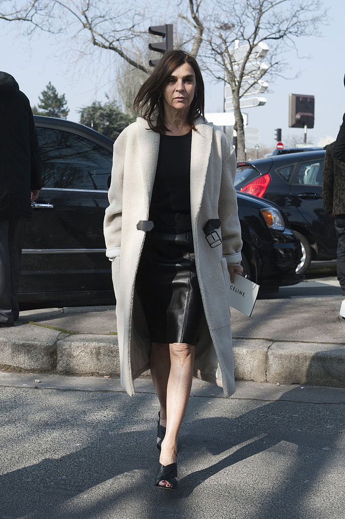 Carine Roitfeld countered a slick leather pencil with a cream-colored, furry topper.