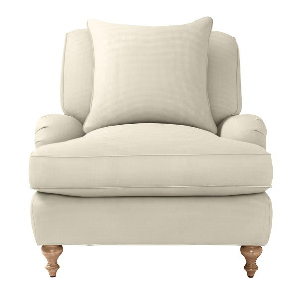 This white linen chair ($1,450–$1,750) has an effortlessly chic feel, similar to the seating in each villa.