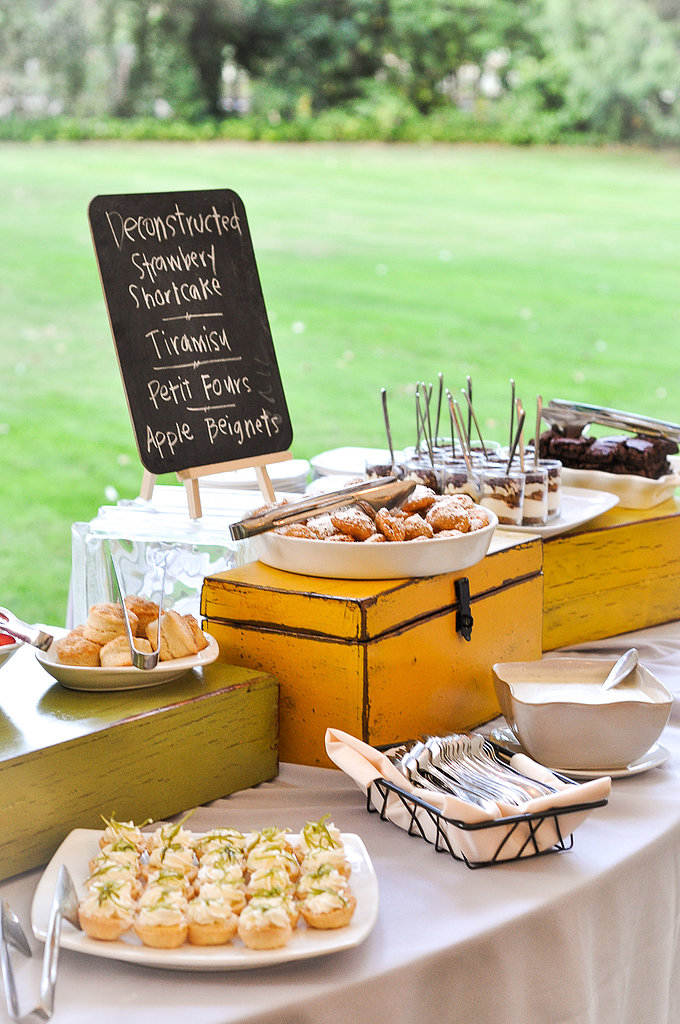 A chalkboard and wood boxes displayed the buffet of petit fours and other delights provided by Pacific Connection Catering. Source: Juliette Tinnus