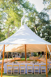 Rather than having a specific vision, the bride and groom began the planning process by emphasizing how they wanted their wedding to feel. The tent from Zephyr Tents was a strong design concept from the start.  Source: Juliette Tinnus