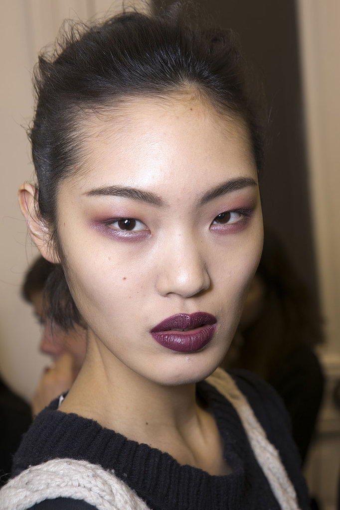Go for rich plums on your eyes and lips, à la Anthony Vaccarello. Swipe a shimmering purple shadow across your eyes and an aubergine bullet over your lips.