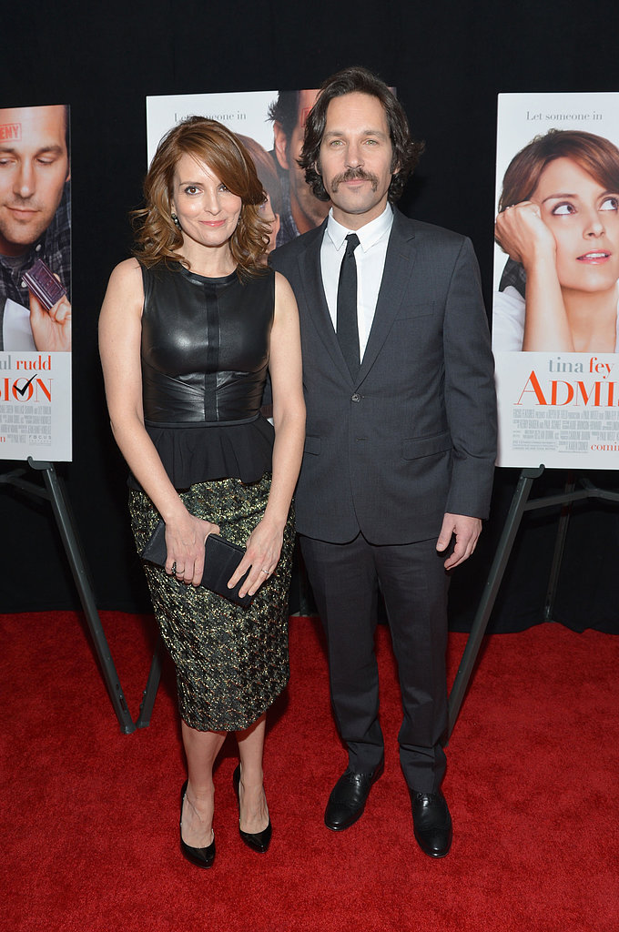 Tina Fey held a clutch while posing with Paul Rudd.