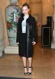 Amanda Seyfried wore a pale blue sheer shirt under her black coat as she arrived at the launch party on Tuesday night.