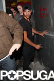 Taylor Lautner went to a concert with Kristen Stewart and a group of friends.