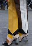 This Fashion Week attendee matched her stunning colorblocked heels with coordinating pants.