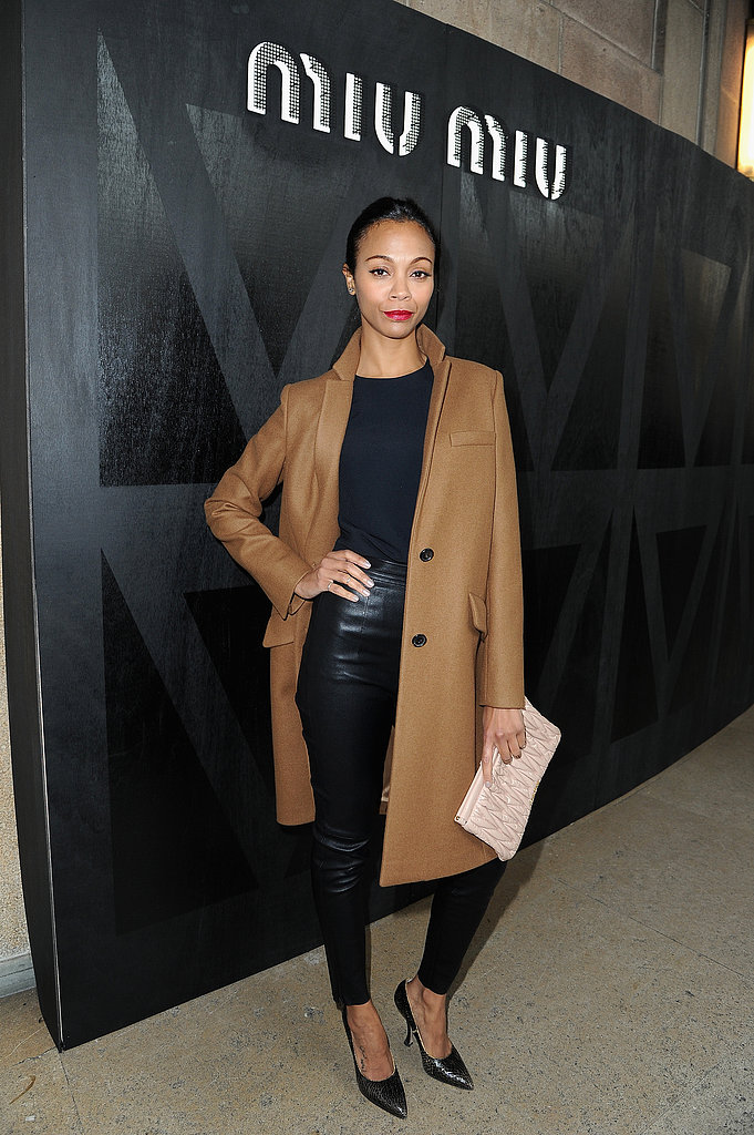 Zoe Saldana was slick in black leather pants and a camel coat at the Miu Miu show at PFW.