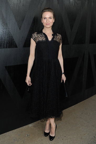Renée Zellweger got dressed up in a ladylike black lace dress and classic pumps at Miu Miu.