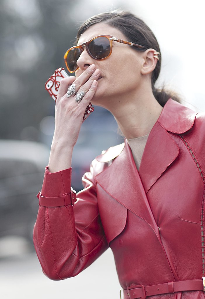 Giovanna Battaglia completed her look with double rings and tortoise sunglasses — we also love her arty iPhone case!