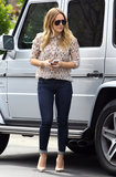 Hilary Duff tucked this Tory Burch seahorse-print blouse ($275) into a pair of skinny jeans, then completed her daytime chic via nude pumps and aviators.