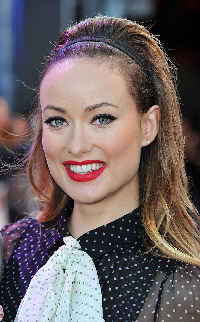 At the London Cowboys & Aliens premiere, Olivia turned up the heat with a bright red lip color and voluminous hairstyle.