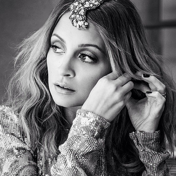 We love the look of Nicole Richie's embellished hair piece and inky black nail polish. Source: Instagram user nicolerichie