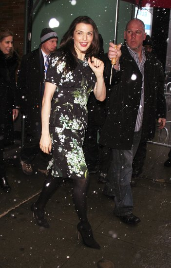 En route to promote the flick on Good Morning America, Rachel Weisz braved the NYC snow in a sweet floral Dolce & Gabbana dress, black tights, and classic black pumps.