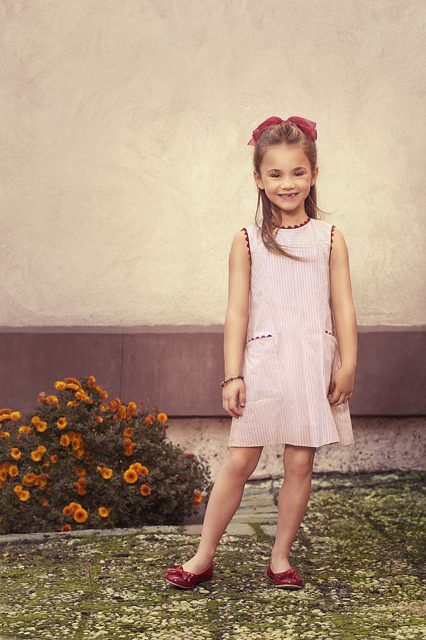 """The Red Vintage Striped Dress ($135) was designed for """"Isabelle"""" — a curious Parisian 5 year old with an interest in the arts, just like her maman, who is a docent at the Musee D'Orsay."""