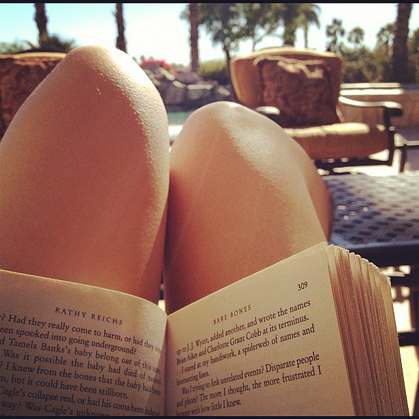 I snapped this pic of myself reading Bare Bones by Kathy Reichs during a weekend getaway in Palm Springs.
