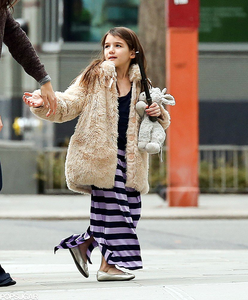 Suri Cruise held onto a stuffed animal.