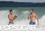 Liam Hemsworth and a friend went bodysurfing.