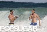 Liam Hemsworth and a friend went bodysurfing.