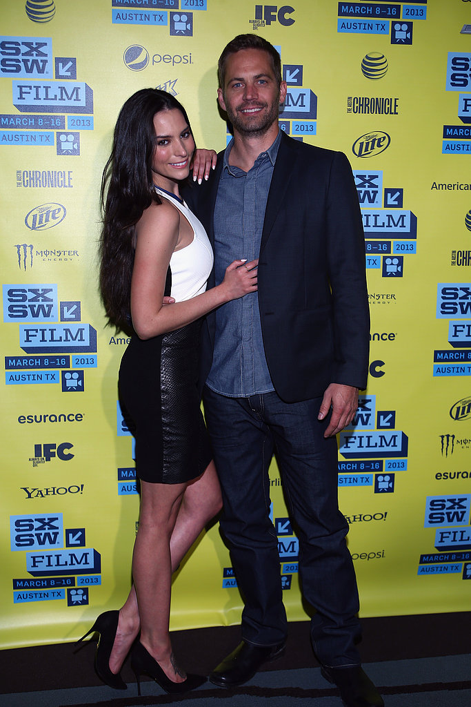 Paul Walker was accompanied by Genesis Rodriguez on the red carpet at the Hours premiere.