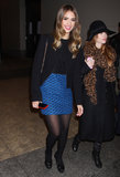 While out and about in NYC, Jessica Alba made her all-black look pop with a blue printed miniskirt.