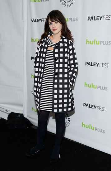Zooey Deschanel mixed prints — a striped Kate Spade dress and a checkered coat — in a chic black and white palette at PaleyFest in LA.