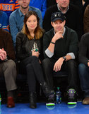 Olivia Wilde chose a rocker-cool leather jacket and quilted ankle boots for a February 2013 Knicks game with fiancé Jason Sudeikis.
