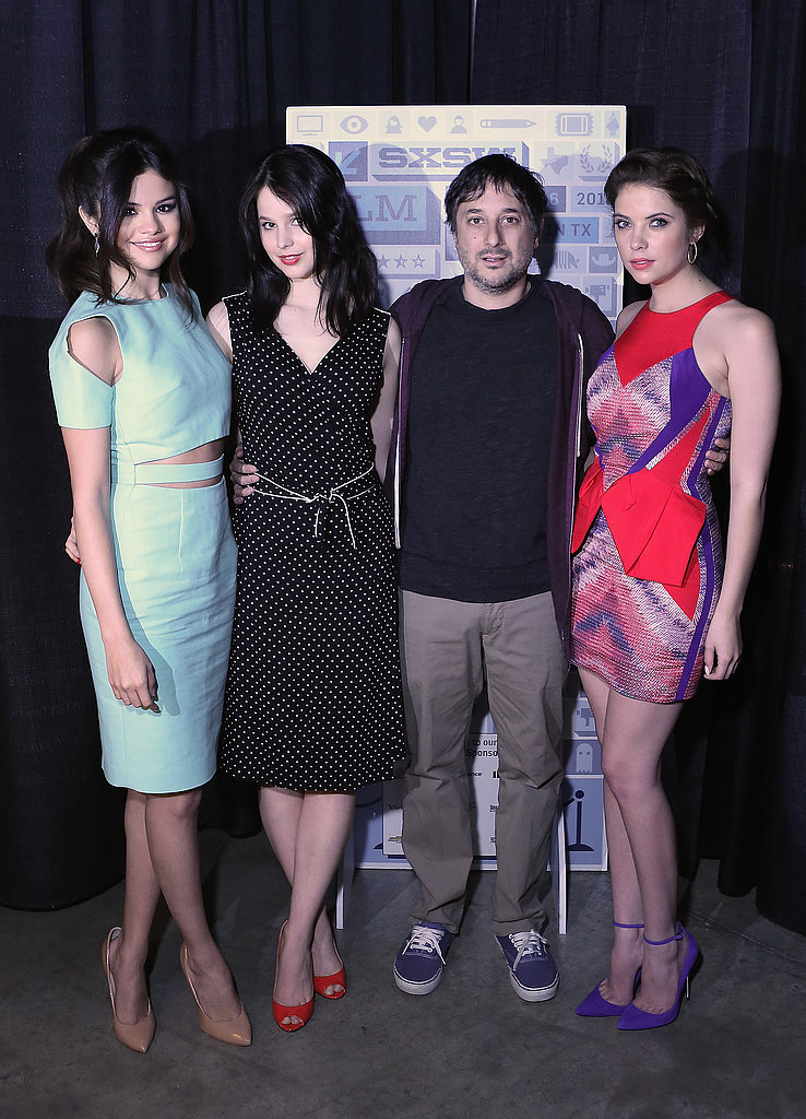 Selena Gomez posed alongside her Spring Breakers director and co-star Ashley Benson at a cast photo op. Selena worked a cut-out pastel Cushnie et Ochs sheath and Ashley chose an all-over abstract-print mini with Monika Chiang electric blue pumps.