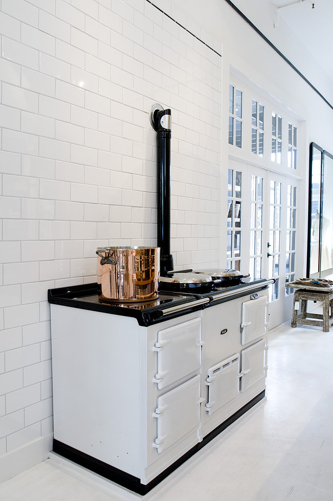 White subway tile is also a foolproof way to achieve a classic look at an affordable price. The rosy hue of the copper pot adds just a hint of color while still serving as a neutral. Takeaway: save on white subway tile, and invest in copper cookware. Photo courtesy of Angie Silvy